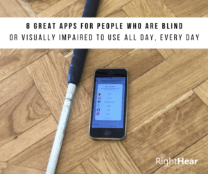 An iPhone and a white cane