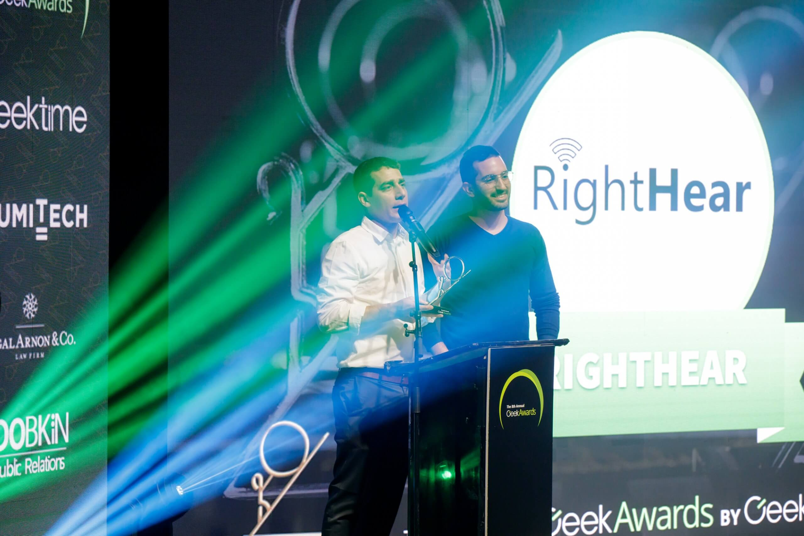 RightHear founder on stage, receiving an award